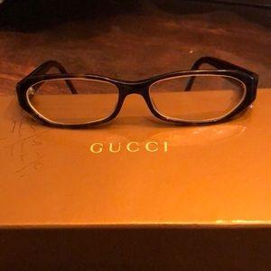 Gucci reading glasses .